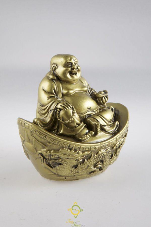 Zlatý sediaci Budha na zlatom ingote