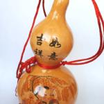 Tekvica Wu Lou s obrázkom dieťatka s ingotmi